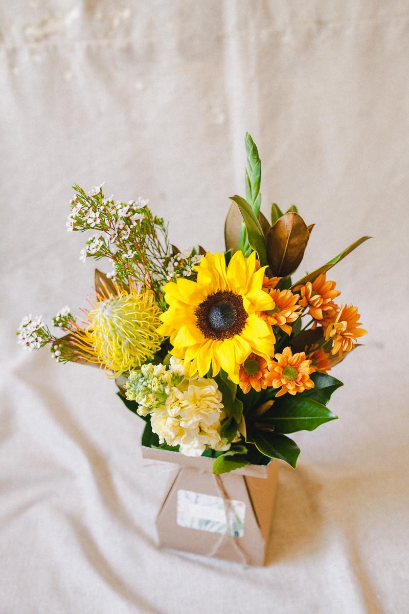 Posy ingredients: Sunflower; Pincushion; Gladioli; Chamelaucium; Little Gem; Spray Chryssie; and Stock