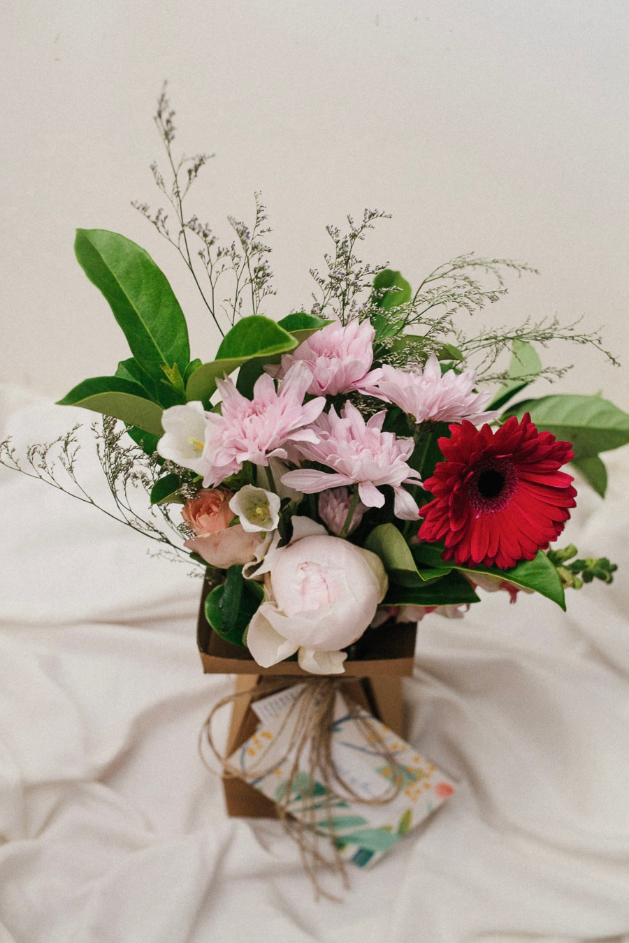 Petite Posy featuring Peony, Misty, Gerbera, Rose, Canterbury Bell, Viburnum and Snap Dragon