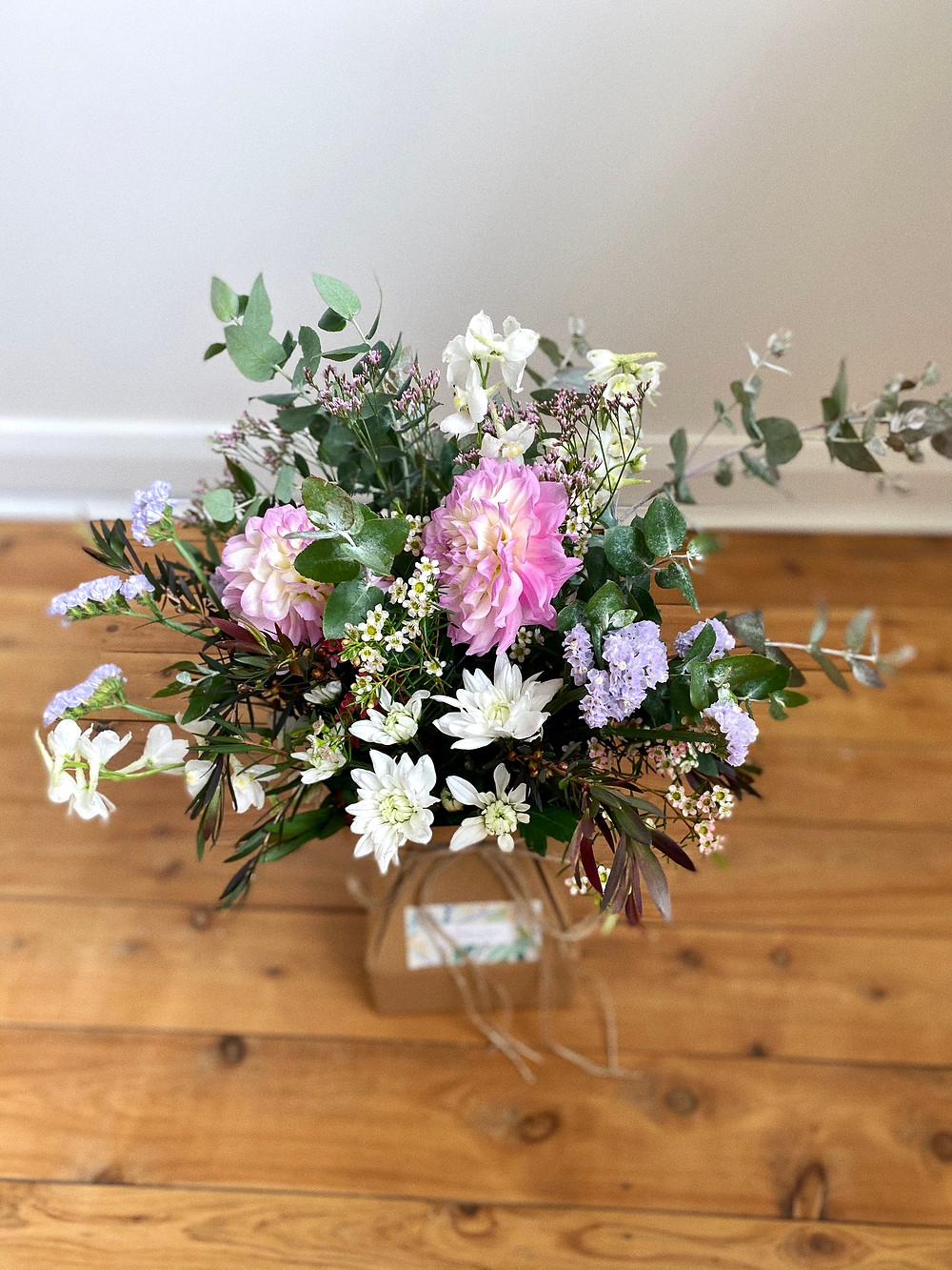 One Design Posy featuring Dahlia, Chryssie, Statice, Gum, Copper Tea tree, Misty and Delphinium.