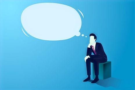 businessman-sitting-thinking-with-big-em