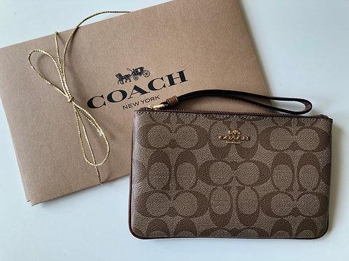 Bolsa de mão Wristlet Coach