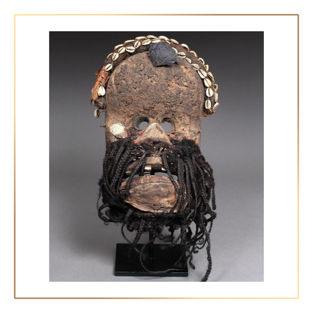 Fetish mask of ape man with prognathic mouth. Wood, braided human hair, cowrie shells, vegetable matter, earthy amalgam and old traces of internal portage. Wobe, Republic of Ivory Coast.