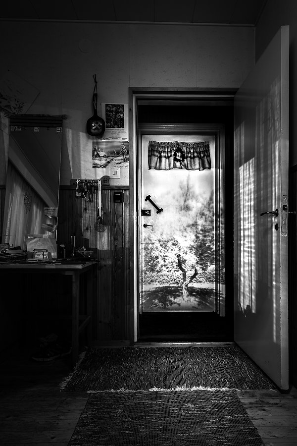 Black and white image by Minna Lehtola from the series NightHouse, long exposure, projected image combined with ambient light