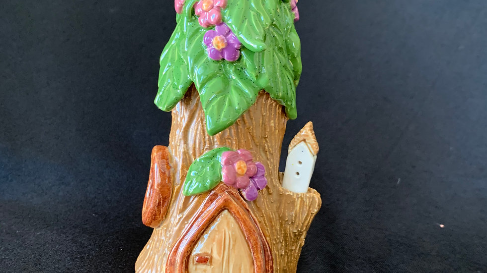 gnome house with bird house