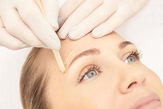 Sugar hair removal from woman body. Wax epilation spa procedure. Procedure beautician fema