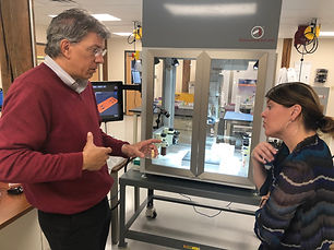 Advanced Solutions Chief Scientist Jay Hoying discussing a tissue model with a radiologist & BioAssemblyBot in the background of a biology lab