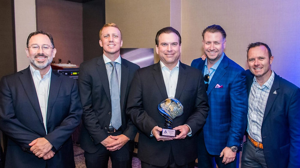 Michael Golway holding the YPO 2017 Global Innovation Award