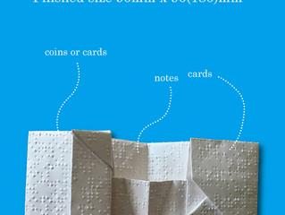 古紙回収出来ない丈夫な点字用紙で製作した折財布です。