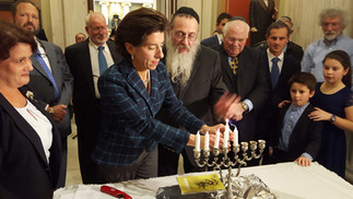 Honorable Governor Gina Raimondo lights the menorah at the State House