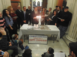 Governor Gina Raimondo lights Hanukah Candles at the State House