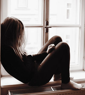 Woman on Window Sill_edited.jpg