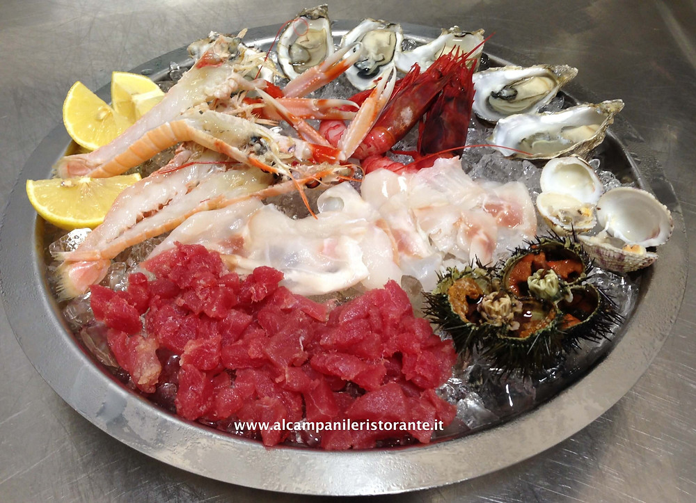 plate of raw seafood in puglia