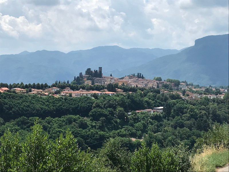 Italian village surrounded by green mountains