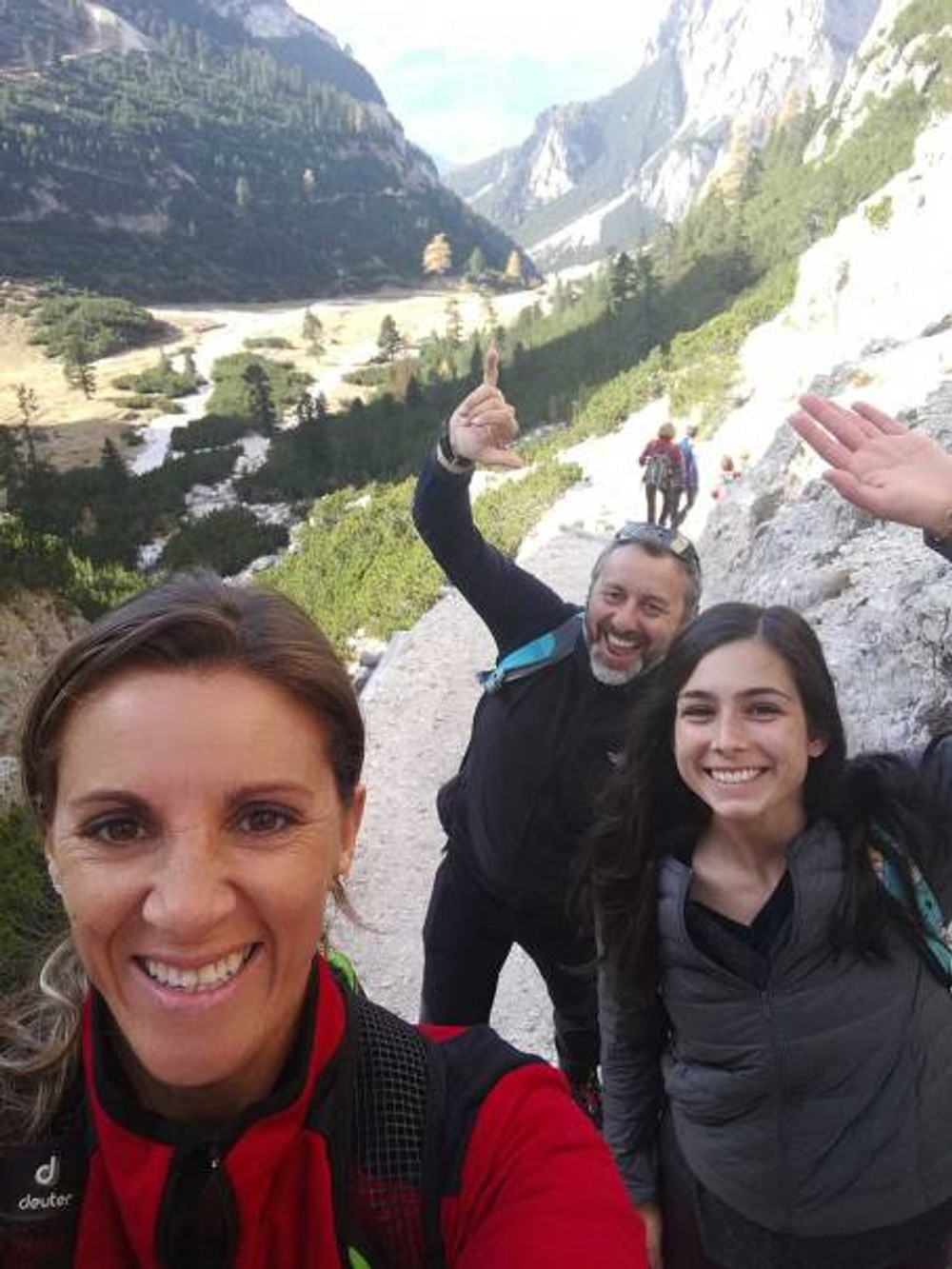 three-hikers-in-the-dolomite-mountains-in-italy