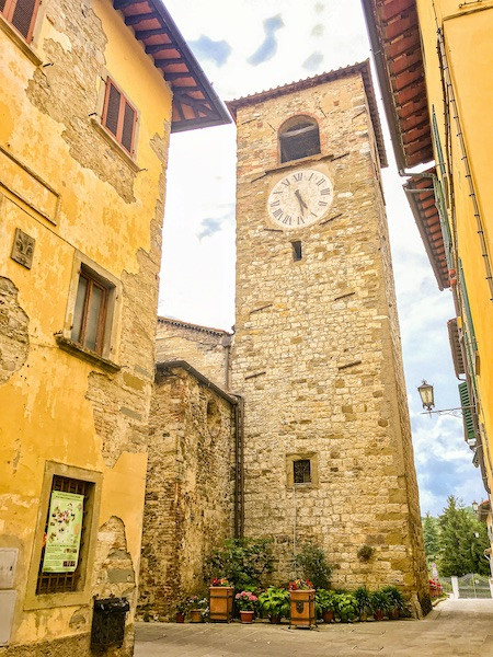 An ancient clocktower in an Italian village