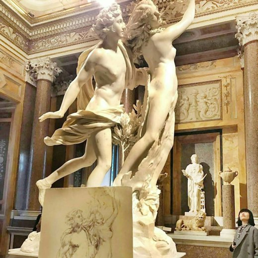 Bernini's statue of Apollo and Daphne with an artist's sketch