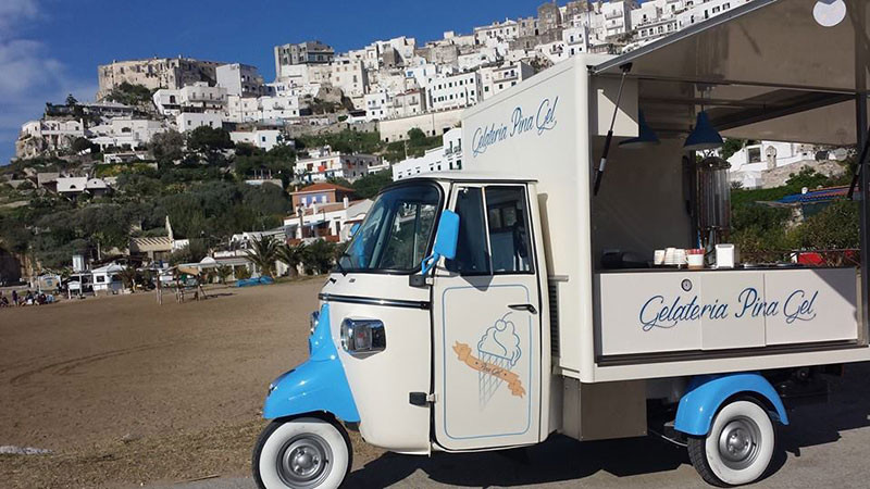 three-wheeled truck selling gelato on the beach below the Southern Italian town of Peschici