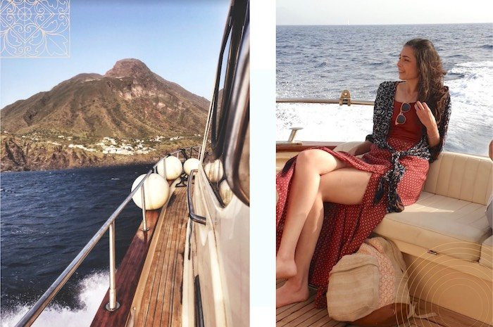 a happy woman on a boat headed for the island of Stromboli