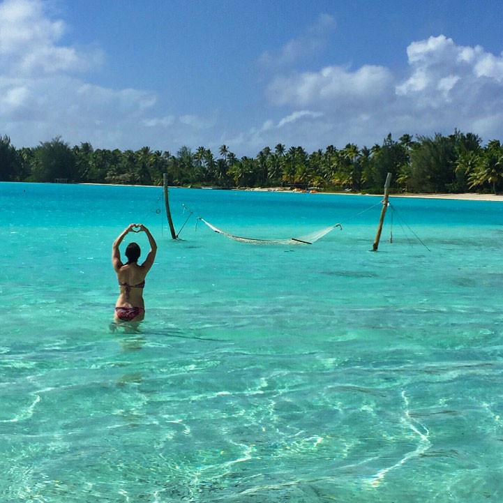 girl in ocean with hammock