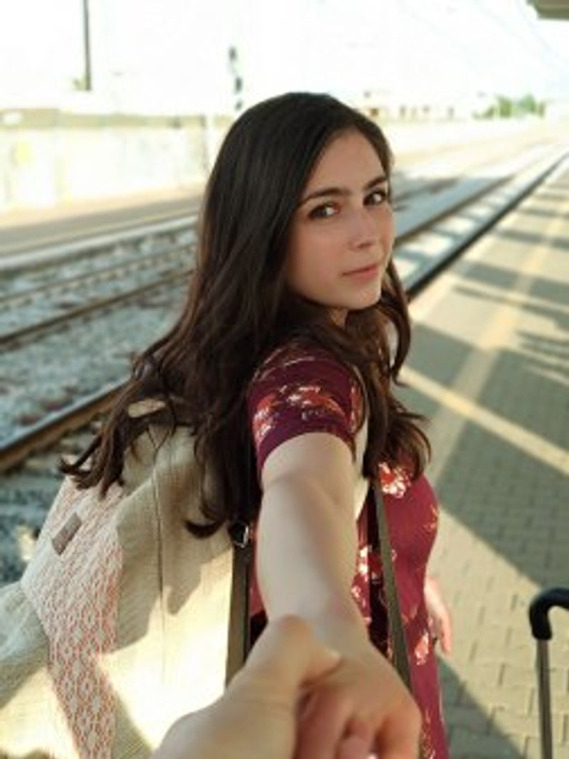 girl at train tracks platform italy