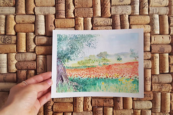 Watercolor painting of poppy field in italy with an olive tree against cork background