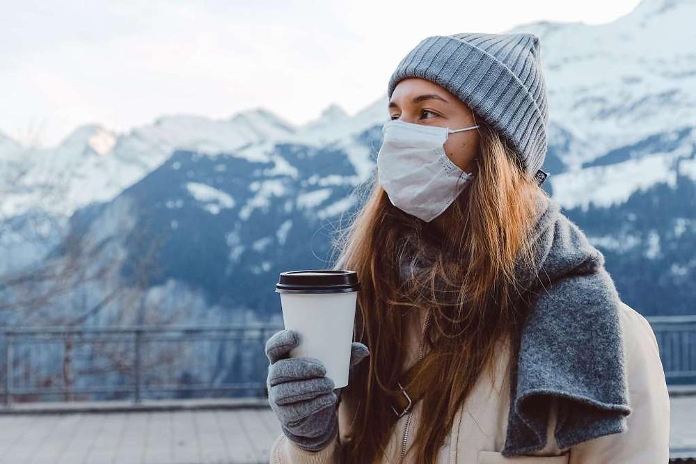 woman travel mountains winter coffee adventure