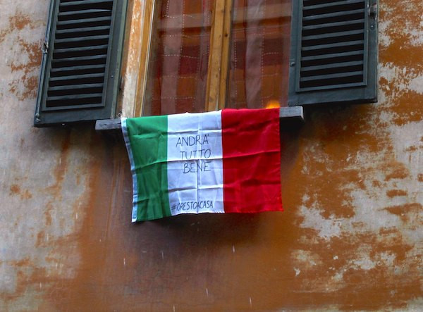Italian flag hanging from an Italian window during the COVID-19 lockdown