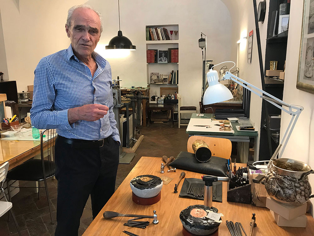 italian metalsmith man in his artisan studio in oltrarno florence italy