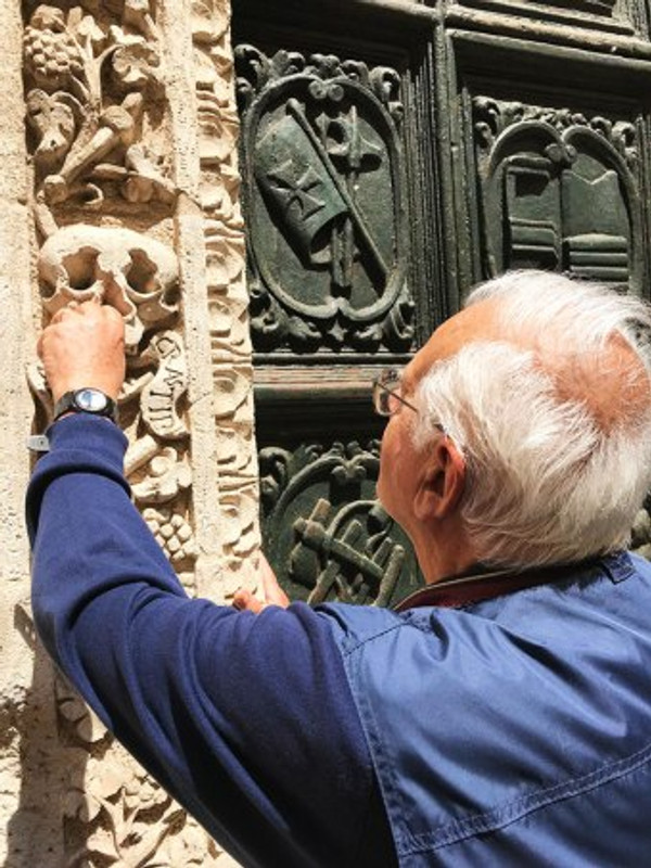 local man in monopoli italy points out architectural details on a church