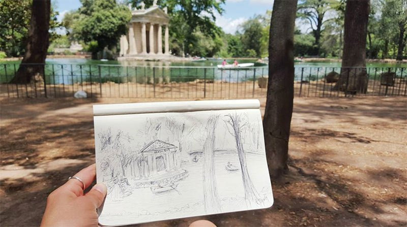 sketching in a a park in rome by a pond