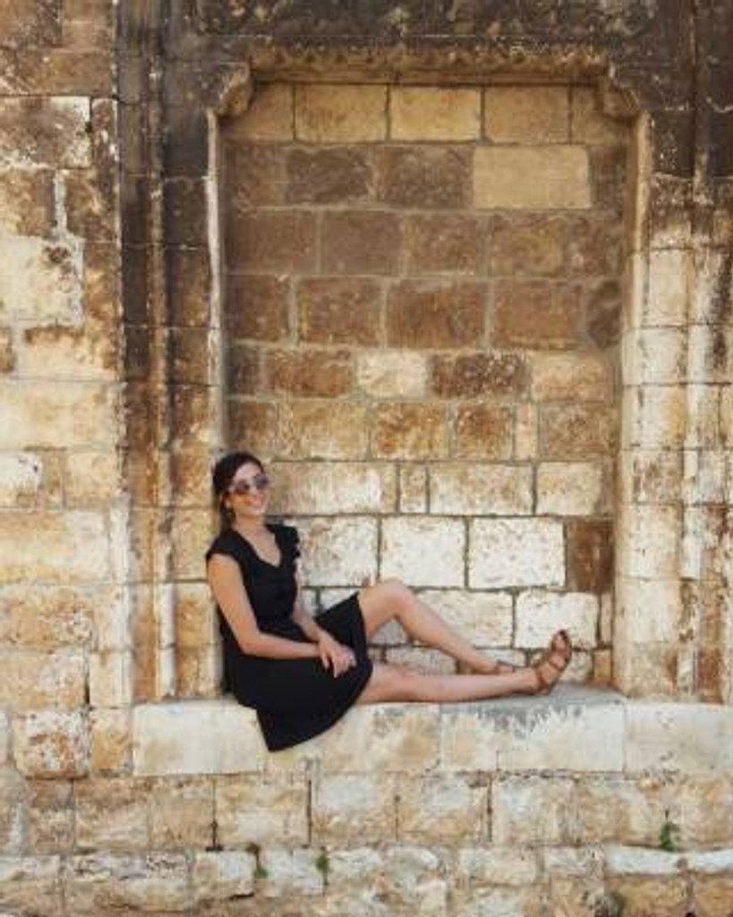 girl sitting on old building in puglia italy