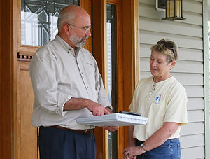 Explaining energy survey to homeowner.jp