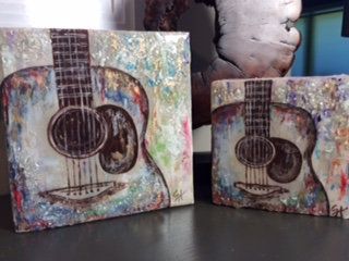 Multi-Colored Acoustic Guitar on Wood