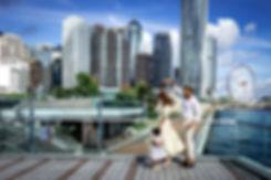 Hong Kong Skyline with family dancing