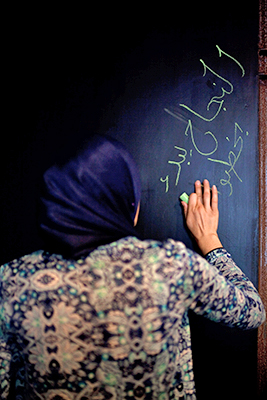 Writing on the Blackboard in Amina