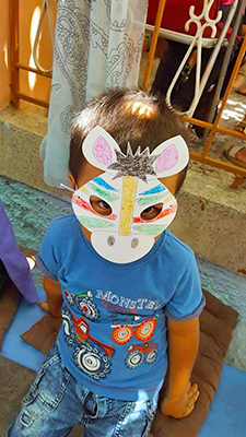 A Boy wearing a mask at Bashira