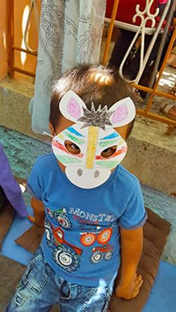 A Boy wearing a mask at Bashira
