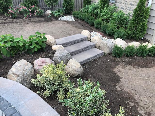 softscape versus hardscape backyard project, boulders, stone, shrubs