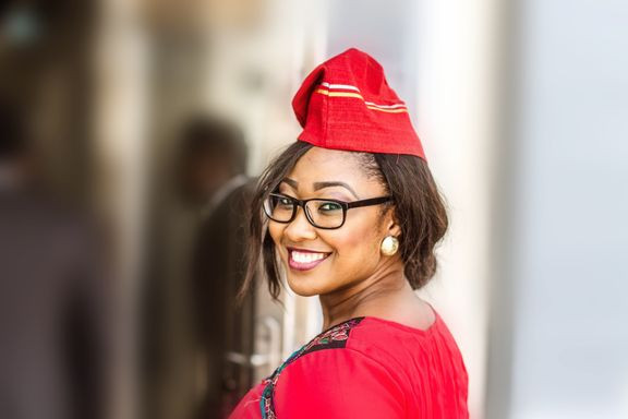 Chidinma Onuzo, balanced wheel, Tolulope Olajide, wife died, I love my wife, Chidinma is wearing a red african hat and with a full smile