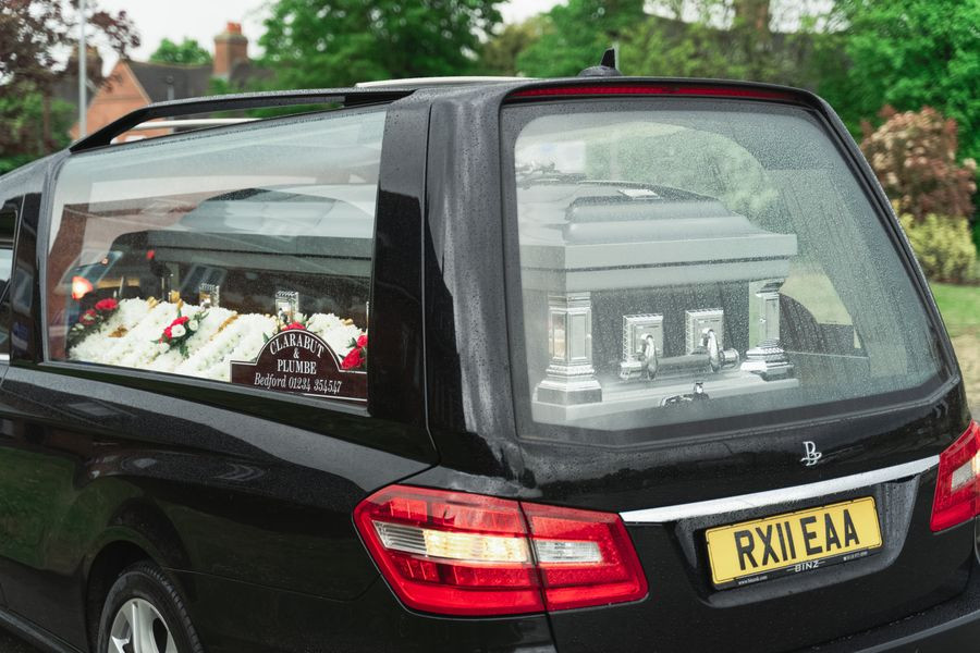 Hearse with Chidinma Olajide in coffin parked in front of the house for last respect   Balanced Wheel