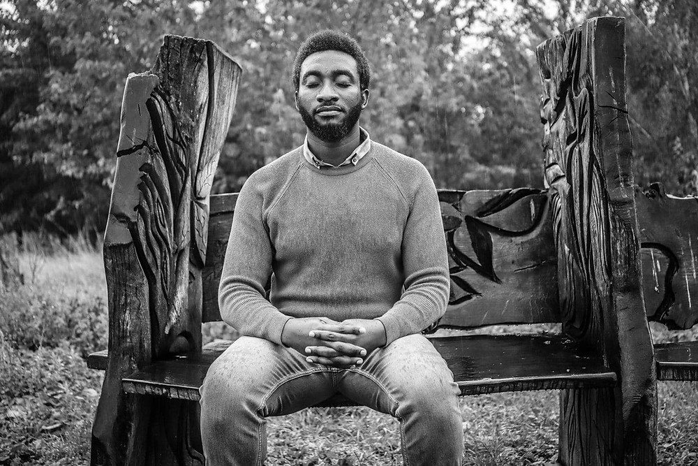 Tolulope Olajide sat with eyes closed on a bench while the rain beats him