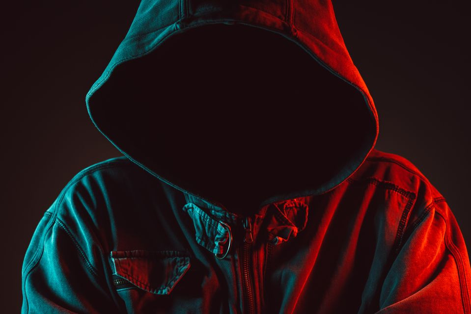 Faceless man in red and blue lit low key portrait of hooded person   Balanced Wheel