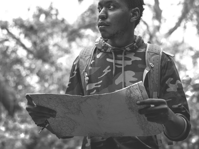 Man checking map in the forest | Balanced Wheel | Express your grief