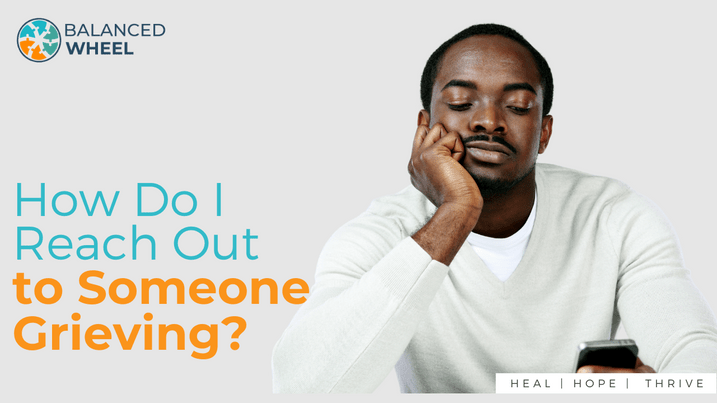 Pensive african man starign down at his smartphone | Balanced Wheel | How to reach out to somone grieving blog post