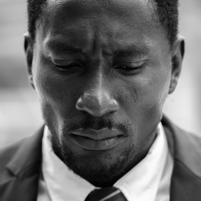 Unresolved grief face of stressed african man looking sad Balanced-Wheel