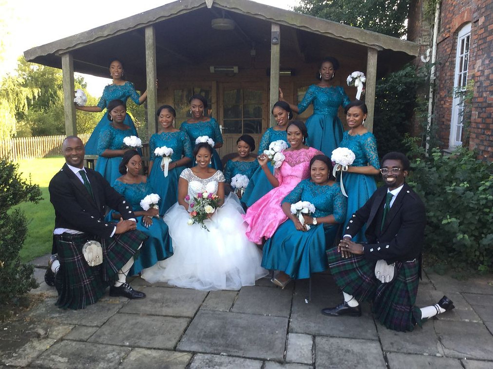 Wedding picture of Chidinma Olajide with her beautiful 11 bridesmaid and 2 bridesmen dressed in kilt   Dealing with Grief - Frozen Moments and Memories of Loved One   Balanced Wheel