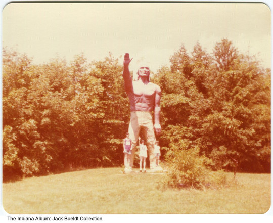 Children with a statue at the Indian Museum at Eagle Creek Park, Indianapolis, Indiana, July, 1976