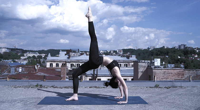 Girl Doing Yoga on a Rooftop_edited.jpg