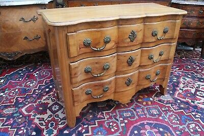 Commode-arbalète