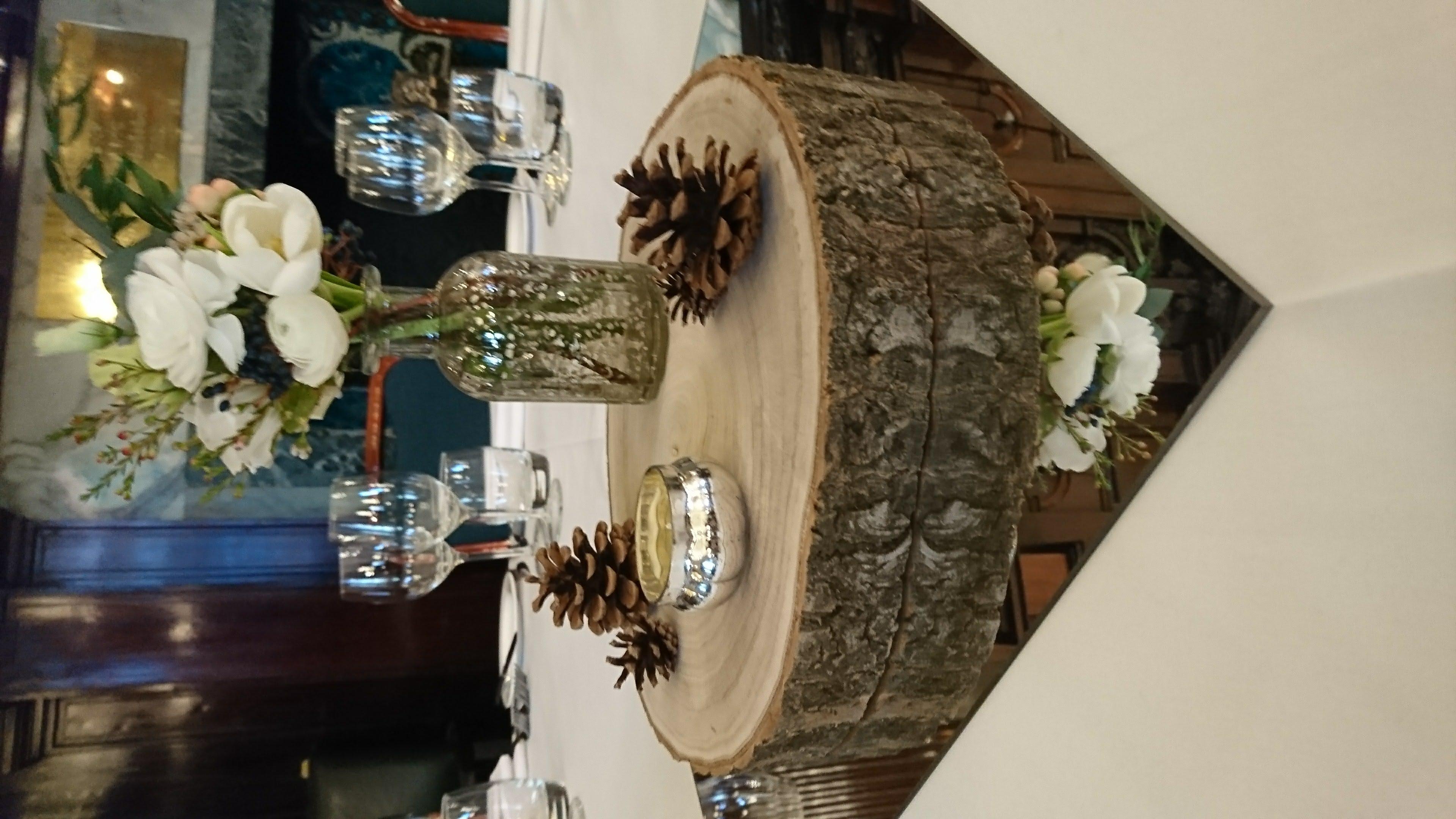 Rustic log slice wedding centrepiece